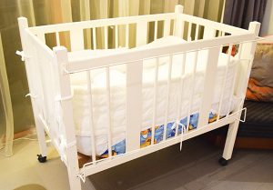 white bed for child and baby at hotel room