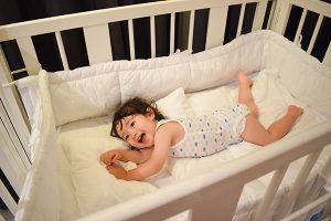 white bed for child and baby